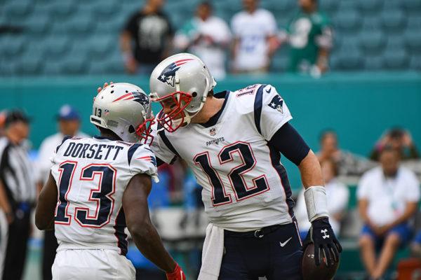 New England Patriots quarterback Tom Brady (12) and New England Patriots wide receiver Phillip Dorsett (13)