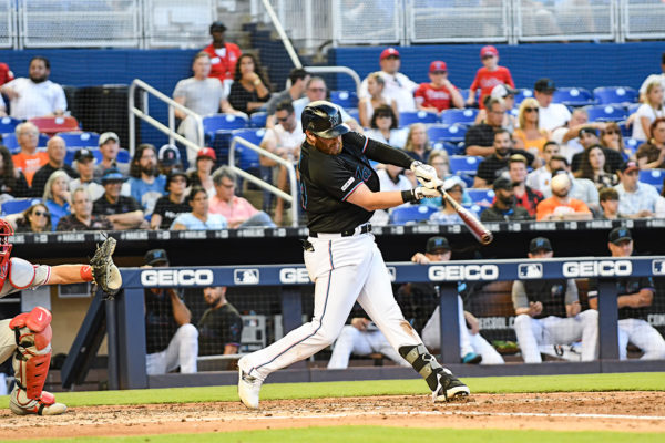 Miami Marlins left fielder Austin Dean (44) hits a homerun