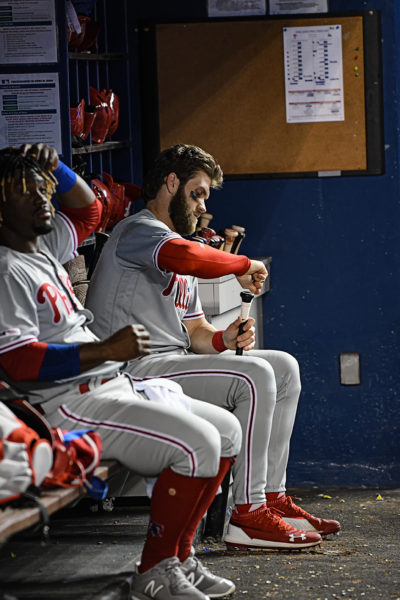 Philadelphia Phillies right fielder Bryce Harper (3) tapes his bat