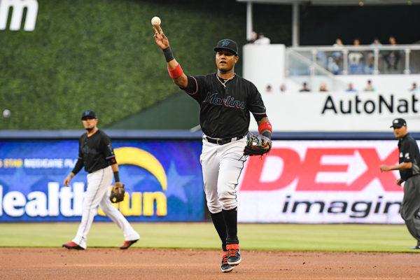 Miami Marlins second baseman Starlin Castro (13) throws the ball to first base
