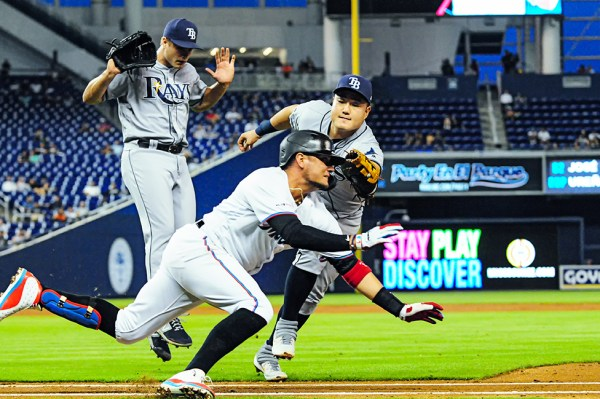 Tampa Bay Rays first baseman Ji-Man Choi (26) tags Miami Marlins shortstop Miguel Rojas (19)