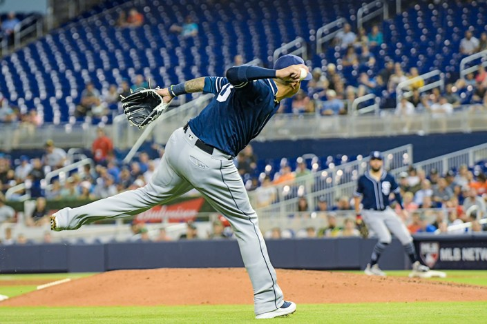 San Diego Padres third baseman Manny Machado #13 throws to first - San Diego Padres vs. Miami Marlins at Marlins Park