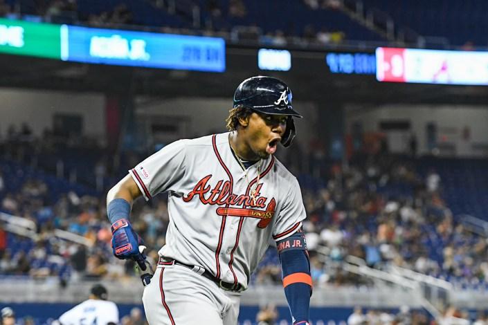 Atlanta Braves left fielder Ronald Acuna Jr. #13 celebrates hitting a game tying homerun