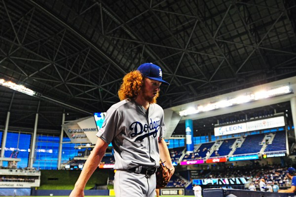 LA Dodgers starting pitcher Dustin May (85) walks back to the dugout