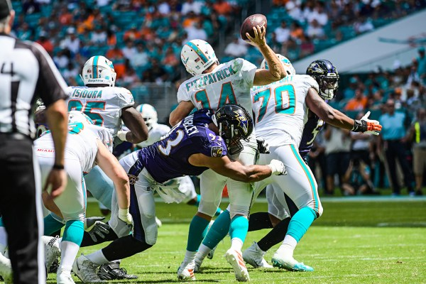 Baltimore Ravens nose tackle Chris Wormley (93) hits Miami Dolphins quarterback Ryan Fitzpatrick (14) as he throws | Baltimore Ravens vs. Miami Dolphins | September 8, 2019 | Hard Rock Stadium