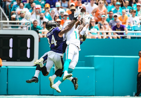 Miami Dolphins wide receiver DeVante Parker (11) hauls in a pass between 2 defenders | Baltimore Ravens vs. Miami Dolphins | September 8, 2019 | Hard Rock Stadium