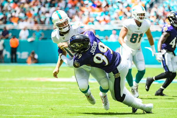 Baltimore Ravens outside linebacker Matt Judon (99) hits Miami Dolphins quarterback Ryan Fitzpatrick (14) | Baltimore Ravens vs. Miami Dolphins | September 8, 2019 | Hard Rock Stadium