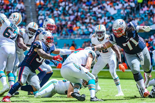 Miami Dolphins quarterback Ryan Fitzpatrick #14 is sacked | New England Patriots vs. Miami Dolphins | September 15, 2019 | Hard Rock Stadium