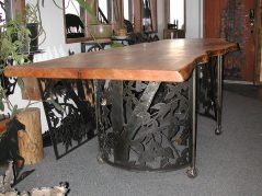 Gathering table with salvaged urban hardwood