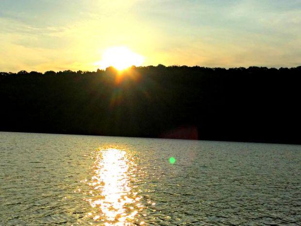 Sun popping over the trees at Beaver Lake in Northwest Arkansas