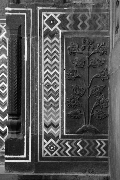 In the Guest House, to the east of the mausoleum building. These floral bas-relief panels are similar to those inside the mausoleum, but made in red sandstone instead of marble.