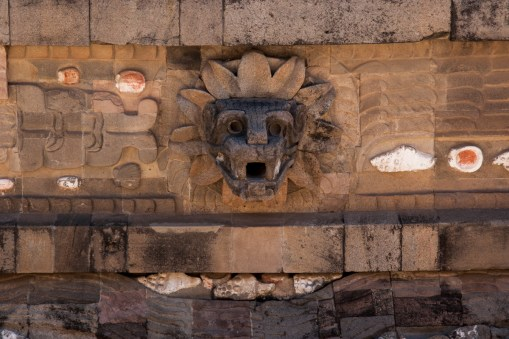 Representations of the feathered serpent alternate with those of Tlaloc across the facade of the temple. Here you can also see the repetition of shell motifs.