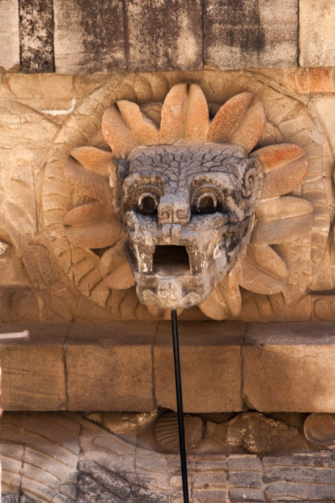 The placement of the feathered serpent heads around this temple may be related to the calendar. Each one has an open space for its mouth, and the people of Teotihuacan may have moved some type of place marker from one to another to signify events on the ritual calendar.