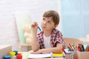 Boy thinking and writing