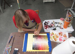Student painting the Zorn color chart