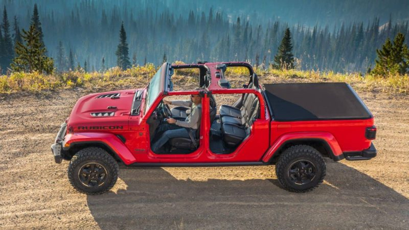 Display Red gladiator with doors off on a dirt path
