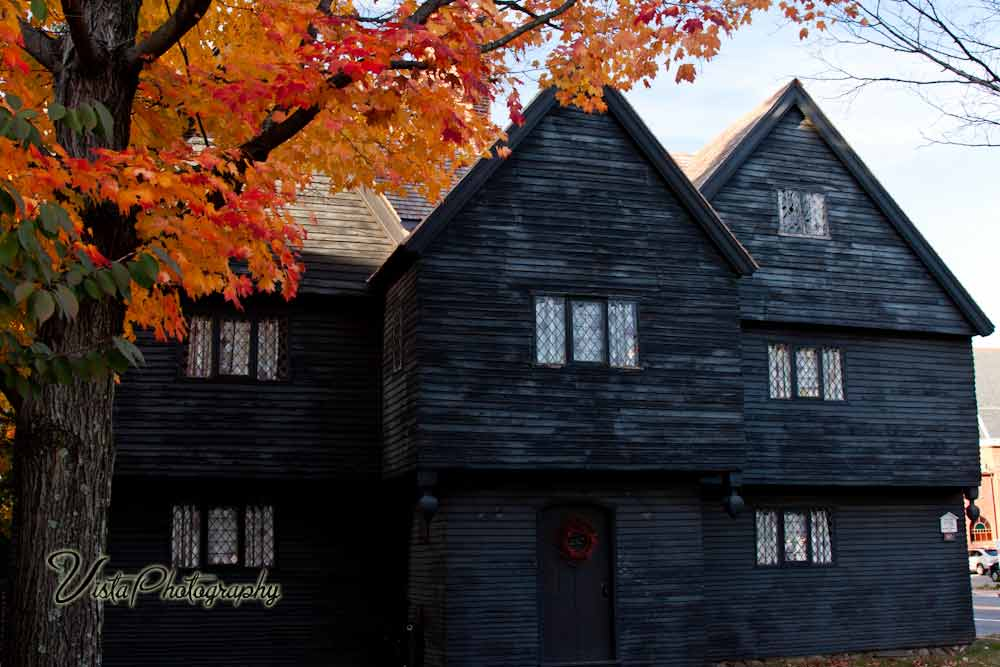 Salem Witch house with fall foliage maples, 1692, Abigail Williams, Alice Parker, Ann Pudeator, antique, architecture, Autumn, Autumn foliage, Autumn foliage New England, Bridget Bishop, coastline, Color, colors, Corey, Corwin House, Court of Oyer (to hear) and Terminer (to decide), Court of Oyer and Terminer, downtown, Elizabeth Howe, Elizabeth Parris, Essex street, Fall, Fall Foliage, Foliage, George Burroughs, George Jacobs, Giles, Good, hangings, images by Jeff Folger, John Proctor, John Willard, Judge Jonathan Corwin, Landscape, maple leaf, Margaret Scott, Martha Carrier, Martha Corey, Mary Eastey, Mary Parker, Massachusetts, Massachusetts Bay Colony, memorial, museum, New England, New England Autumn, New England color, New England fall foliage, New England leaves, new england photography, Ocean, peine forte et dure, Puritan colonists, Rebecca Nurse, Rustic New England, Salem, Salem attraction, Salem fall colors, Salem fall foliage, Salem MA, Salem Massachusetts, Salem Street scene, Salem Town, Salem Village, Salem Witch House, Salem Witch museum, Samuel Parris, Samuel Wardwell, Sarah, Sarah Osborne, Sarah Wildes, Scenic New England, scenic Salem Landscape, sea, spectre evidence, Sr, supernatural, Susannah Martin, Travel, vistaphotography, Wilmot Redd, Witch House, Witch hysteria, Witch trials, witchcraft