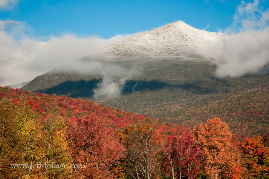 at the foot of mount Washington trees are a tapestry of red gold and orange hues in fall
