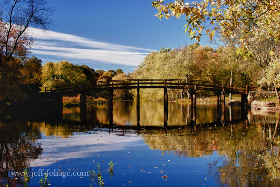 View from a floating dock below the old Manse and upriver from the Old North Bridge in Concord MA