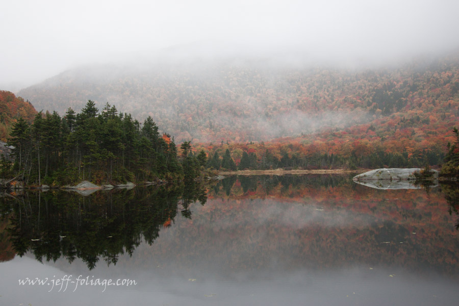 below the Kinsman Notch the surface of the Beaver pond reflects the autumn colors of New England