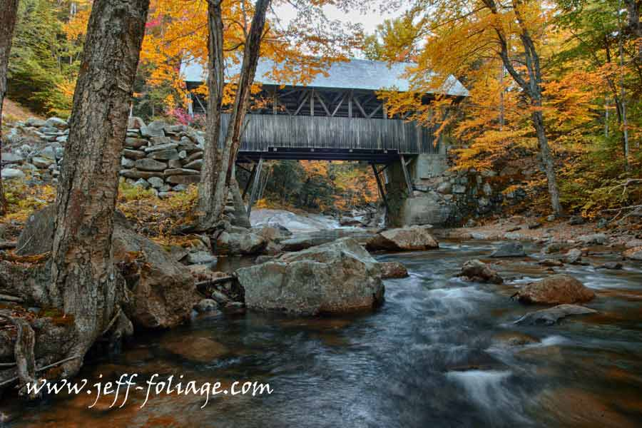 New England Photography of Early fall color? Franconia Notch is a major mountain pass through the White Mountains of New Hampshire. Dominated by Cannon Mountain to the west and Mount Lafayette to the east#Vistaphotography #JeffFolger, #JeffFoliage,