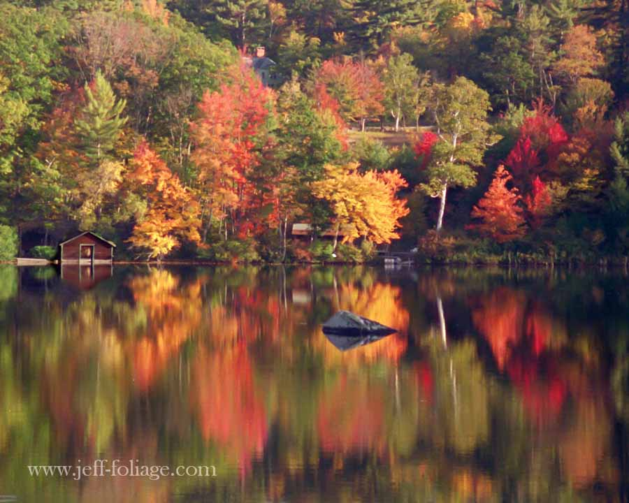 Colorful reflection on little lake below Chocorua
