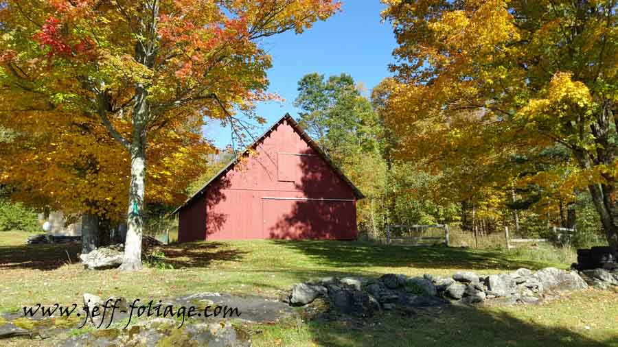 Red Barn under blue sky and yellow fall colors