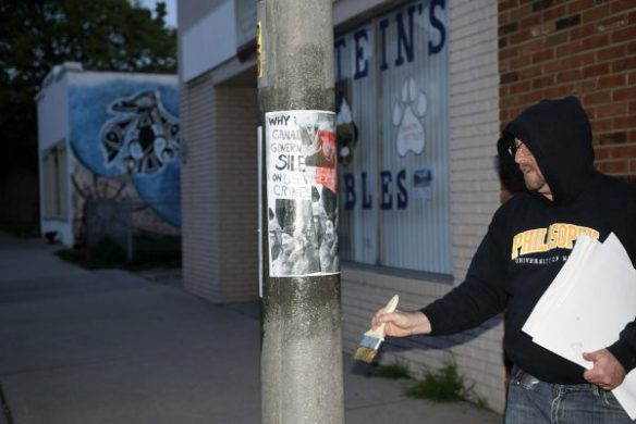 """Postering for Stories to the Streets:  Vita Brevis, Ars Brevis"""" part of Mayworks Windsor 2016.  Photo:  Doug MacLellan."""