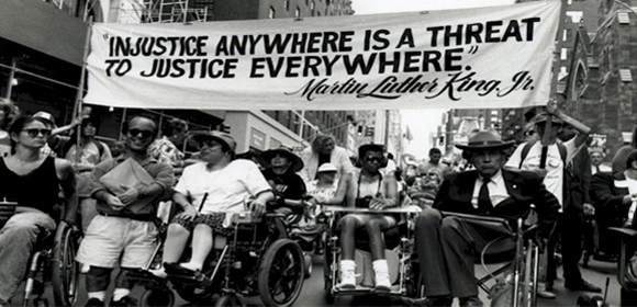 Disability protest with famous MLK quote