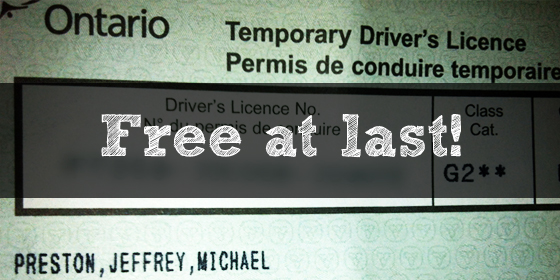 "Photo of a temporary G2 license with ""Free at last"" written over top"