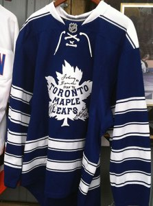 Leafs sweater signed by Baun, Bower and Jeffrey