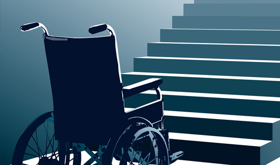 An empty wheelchair at the bottom of a flight of stairs