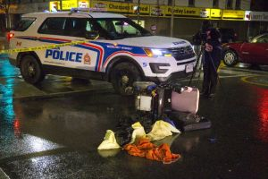 A London Police car parked behind a tipped over wheelchair at the corner of Dundas and Adelaide, with a photographer taking a picture the crime scene