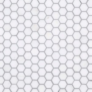 "A white natural-stone mosaic 1"" hexagon tile by Jeffrey Court."