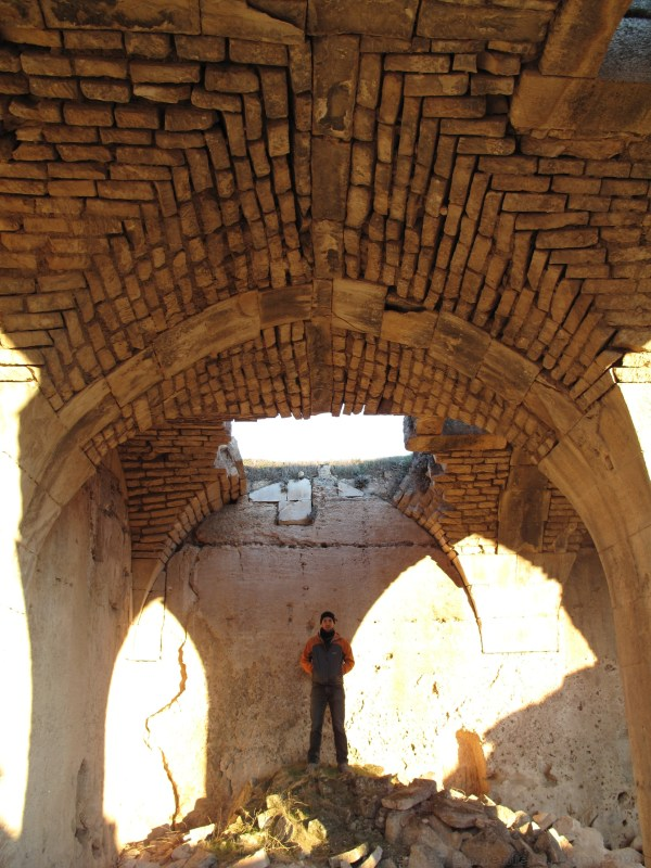 Kirk looking at the surviving arched cieling of the castle ruins at Kasaba