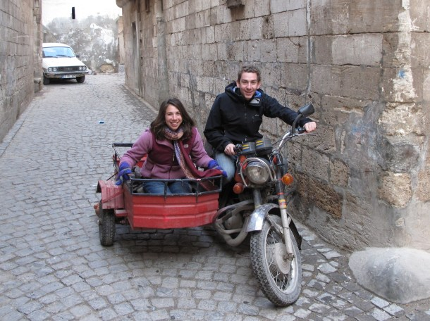 Steph and I riding a motorcycle with a sidecar in Sanliurfa