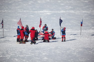 Tourits taking pictures at the Ceremonial South Pole.