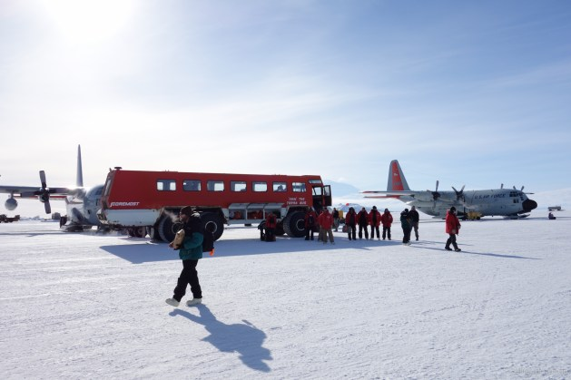 On the Pegasus Ice Runway, with Ivan The Terrabus ready to transport people from the ice runway back to McMurdo Station.
