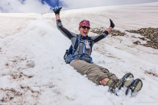 Sliding down the snowfield after a great summit!