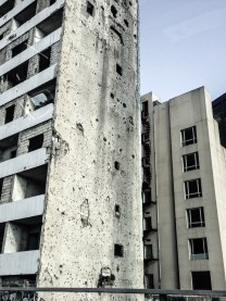 There's a distinct mix of brand new and modern high rises mixed with destroyed and bullet-ridden deathtraps.