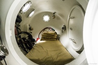 Looking inside the Hyperbaric chamber, it's all setup and ready for one person to enter quickly in an emergency.