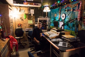 Jeffrey Donenfeld at the controlboard of 104.5 Ice Radio, McMurdo Station, Antarctica