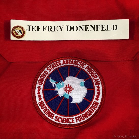 "My name tag and program patch on my ""Big Red"" parka. Note I also added my Explorer's Club members pin."