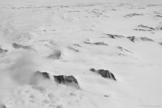 Massive peaks of the Trans-Antarctic Mountains poke out of the polar ice cap. Beautiful.