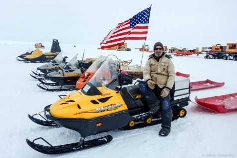 Smouse posing on one of our snowmobiles.