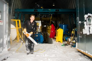 Chansawing the ice floor, to level it out in preparation for loading the winch reel, seen behind me.
