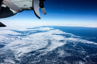 Flying north, the sea ice gradually melts away to reveal open ocean.