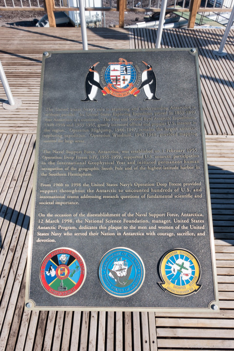 The plaque commemorating Operation Deep Freeze, on the back deck of the Chalet