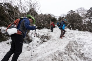Hiking up Mt. Halasan, the well-worn trail gives way to slick snow on the higher half of the mountain. Avid Korean hikers are quick to strap on metal mesh grips to their hiking shoes in order to navigate the snowpack.