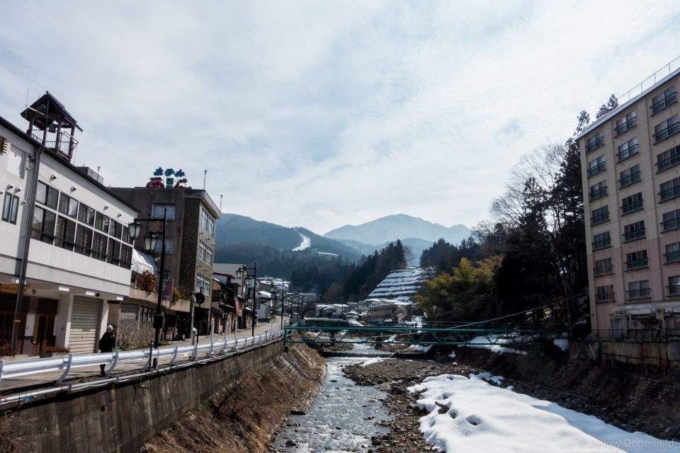 Outside of Shibu Onsen, the river leads to mountains filled with snow - and the ski slopes of Shiga Kogen, Japan's largest ski resort.